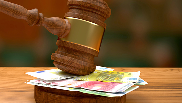 Euro banknotes and judge's gavel
