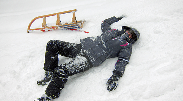 16757389 - girl fell from her sled while tobogganing at imberger horn in the german alps