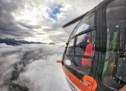 Skifahrer gerät unter Pistenraupe